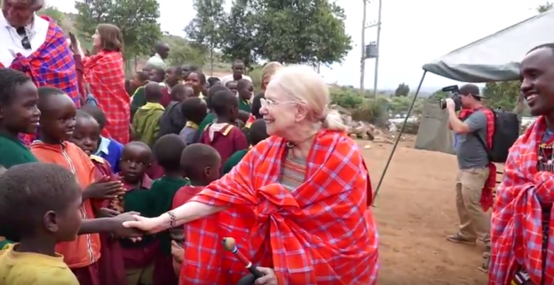 Ms. Judy with children abroad